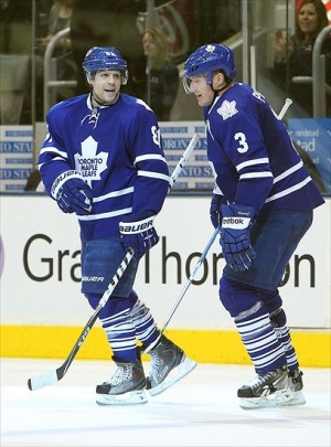 Feb 6, 2012; Toronto, ON, Canada; Toronto Maple Leafs right wing Phil Kessel (81) celebrates his goal with defenseman Dion Phaneuf (3) against the Edmonton Oilers at the Air Canada Centre. The Maple Leafs beat the Oilers 6-3. Mandatory Credit: Tom Szczerbowski-USA TODAY Sports