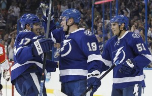 Oct 10, 2013; Tampa, FL, USA; Tampa Bay Lightning left wing Ondrej Palat (18) celebrates with teamamtes after he scored a goal on Florida Panthers goalie Jacob Markstrom (25) during the second period at Tampa Bay Times Forum. Mandatory Credit: Kim Klement-USA TODAY Sports