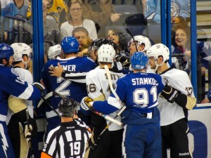 Referees try to sort out a fight between the Tampa Bay Lightning and the Pittsburgh Penguins at the Tampa Bay Times Forum on October 12, 2013. Photo Credit: Tasha N. Meares
