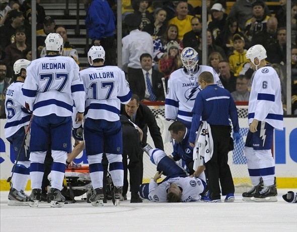 Nov 11, 2013; Boston, MA, USA; Tampa Bay Lightning center Steven Stamkos (91) lays on the ice while being attended to by the medical staff during the second period against the Boston Bruins at TD Banknorth Garden. Mandatory Credit: Bob DeChiara-USA TODAY Sports