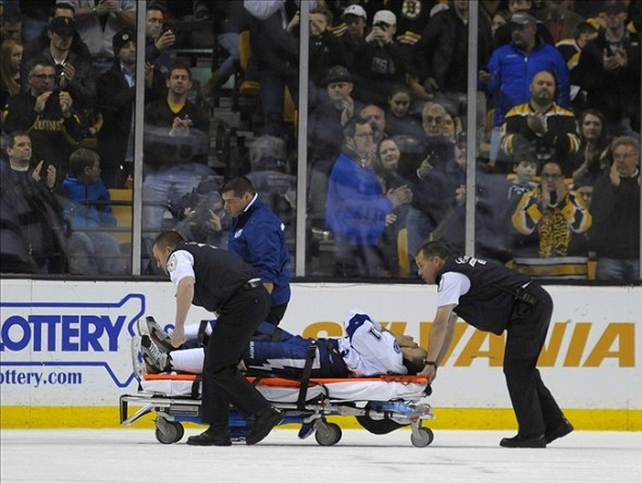 Nov 11, 2013; Boston, MA, USA; Tampa Bay Lightning center Steven Stamkos (91) is wheeled off on a stretcher during the second period against the Boston Bruins at TD Banknorth Garden. Mandatory Credit: Bob DeChiara-USA TODAY Sports