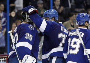 Nov 14, 2013; Tampa, FL, USA; Tampa Bay Lightning goalie Ben Bishop (30) and defenseman Victor Hedman (77) congratulate each other after they beat the Anaheim Ducks at Tampa Bay Times Forum. Tampa Bay Lightning defeated the Anaheim Ducks 5-1. Mandatory Credit: Kim Klement-USA TODAY Sports