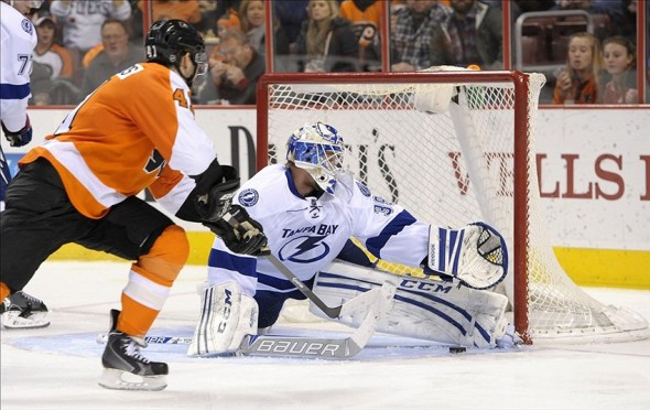 Jan 11, 2014; Tampa Bay Lightning goalie Anders Lindback (39) makes a save against a Philadelphia Flyers defenseman during the second period at Wells Fargo Center. Mandatory Credit: Eric Hartline-USA TODAY Sports