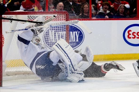 Jan 30, 2014; Ottawa, Ontario, CAN; Tampa Bay Lightning goalie Anders Lindback (39) is ran into by Ottawa Senators left wing Croy Conacher (89) in the second period at the Canadian Tire Centre. Mandatory Credit: Marc DesRosiers-USA TODAY Sports