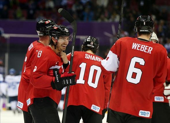 Feb 16, 2014; Sochi, RUSSIA; Canada defenseman Drew Doughty (8) celebrates with teammates after scoring the game-winning goal in overtime against Finland in a men's preliminary round hockey game during the Sochi 2014 Olympic Winter Games at Bolshoy Ice Dome. Mandatory Credit: Winslow Townson-USA TODAY Sports