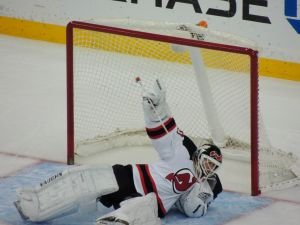New Jersey Devils goaltender Martin Brodeur falls to the ice while making a save. The Tampa Bay Lightning defeated the Devils 3-0 at the Tampa Bay Times Forum on March 15, 2014. Photo Credit: Tasha N. Meares
