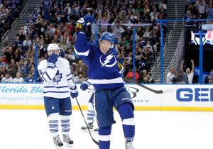 Apr 8, 2014; Tampa, FL, USA; Tampa Bay Lightning left wing Ondrej Palat (18) reacts after scoring a goal against the Toronto Maple Leafs during the second period at Tampa Bay Times Forum. Mandatory Credit: Kim Klement-USA TODAY Sports