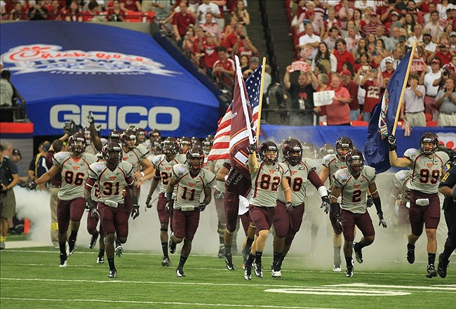 Aug 31, 2013; Atlanta, GA, USA; Virginia Tech Hokies run onto the field prior to facing the Alabama Crimson Tide in the 2013 Chick-fil-a Kickoff game at the Georgia Dome. Mandatory Credit: Daniel Shirey-USA TODAY Sports