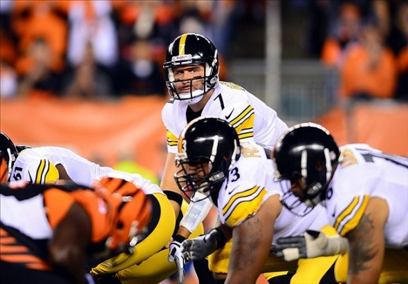 Sep 16, 2013; Cincinnati, OH, USA; Pittsburgh Steelers quarterback Ben Roethlisberger (7) takes a snap from center during the second quarter against the Cincinnati Bengals at Paul Brown Stadium. Mandatory Credit: Andrew Weber-USA TODAY Sports