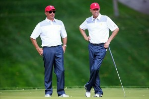 Oct 1, 2013; Dublin, OH, USA; U.S. Team captain Fred Couples (left) with Davis Love III (right) on the green of the ninth hole during a practice round prior to the start of The Presidents Cup at Muirfield Village Golf Club. Mandatory Credit: Allan Henry-USA TODAY Sports