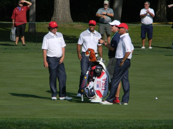 Jason Dufner and Tiger Woods are joined by Captain Fred Couples and caddy Joe LaCava. Photo by Kirk Thoma.