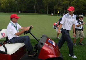 Father and Captain's Assistant Jay Hays is in the cart ytalking to his son Bill Haas. Photo courtesy of Kirk Thoma.