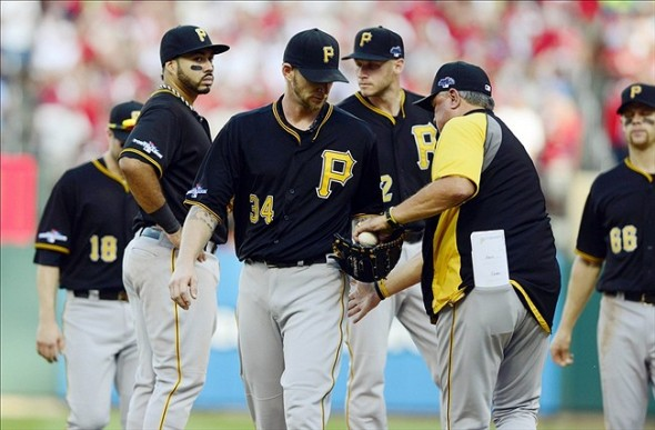 Oct 3, 2013; St. Louis, MO, USA; Pittsburgh Pirates starting pitcher A.J. Burnett (34) is removed from the game by manager Clint Hurdle (right) after giving up seven runs to the St. Louis Cardinals during the third inning in game one of the National League divisional series playoff baseball game at Busch Stadium. Mandatory Credit: Jeff Curry-USA TODAY Sports