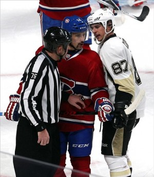Nov 23, 2013; Montreal, Quebec, CAN; Pittsburgh Penguins center Sidney Crosby (87) talks to Montreal Canadiens center Tomas Plekanec (14) next to linesman Michel Cormier (76) during the second period at Bell Centre. Mandatory Credit: Jean-Yves Ahern-USA TODAY Sports