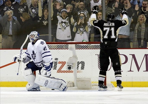 Nov 27, 2013; Pittsburgh, PA, USA; Pittsburgh Penguins center Evgeni Malkin (71) celebrates his game winning goal in the shootout as Toronto Maple Leafs goalie Jonathan Bernier (45) reacts at the CONSOL Energy Center.The Penguins won 6-5 in a shootout. Mandatory Credit: Charles LeClaire-USA TODAY Sports