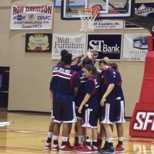 The Duquesne Dukes women's basketball team huddles before its game against Saint Francis. Photo by Zachary Weiss