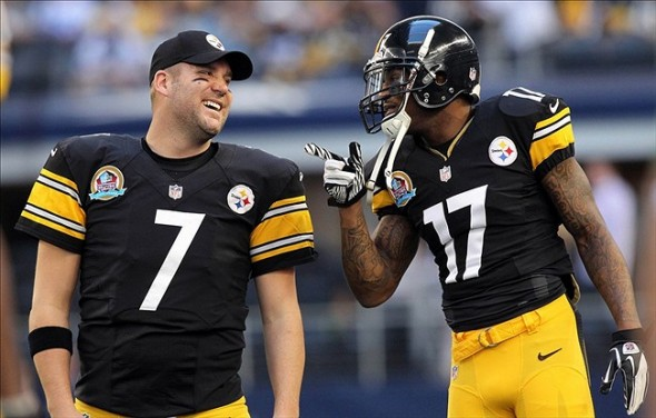 Dec 16, 2012; Arlington, TX, USA; Pittsburgh Steelers quarterback Ben Roethlisberger (7) talks with wide receiver Mike Wallace (17) before the game against the Dallas Cowboys at Cowboys Stadium. Mandatory Credit: Tim Heitman-USA TODAY Sports
