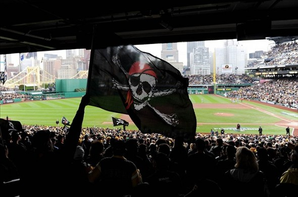 Oct 7, 2013; Pittsburgh, PA, USA; A fan waves a pirate flag before game four of the National League divisional series playoff baseball game between the St. Louis Cardinals and Pittsburgh Pirates at PNC Park. Mandatory Credit: H.Darr Beiser-USA TODAY Sports