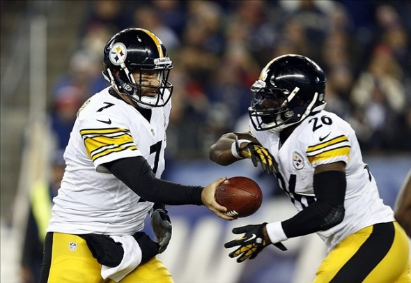Nov 3, 2013; Foxborough, MA, USA; Pittsburgh Steelers quarterback Ben Roethlisberger (7) hands the ball off to running back Le