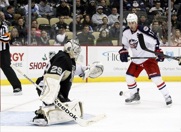 Dec 9, 2013; Pittsburgh, PA, USA; Pittsburgh Penguins goalie Marc-Andre Fleury (29) makes a save as Columbus Blue Jackets center Brandon Dubinsky (17) looks for the rebound during the third period at the CONSOL Energy Center. The Penguins won 2-1. Mandatory Credit: Charles LeClaire-USA TODAY Sports