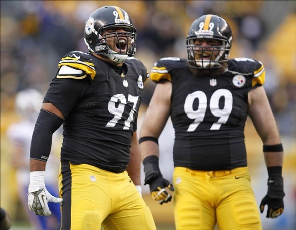 Nov 10, 2013; Pittsburgh, PA, USA; Pittsburgh Steelers defensive end Cameron Heyward (97) and defensive end Brett Keisel (99) react after Heyward registered a sack against the Buffalo Bills during the fourth quarter at Heinz Field. The Pittsburgh Steelers won 23-10. Mandatory Credit: Charles LeClaire-USA TODAY Sports