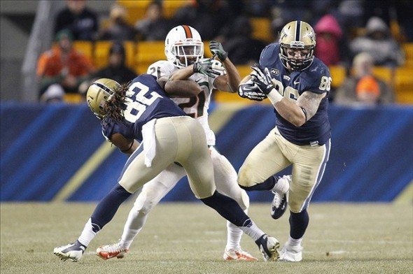 Nov 29, 2013; Pittsburgh, PA, USA; Pittsburgh Panthers tight end J.P. Holtz (86) runs after a pass reception as PITT tight end Manasseh Garner (82) blocks Miami Hurricanes defensive back Antonio Crawford (21) during the third quarter at Heinz Field. Miami won 41-31. Mandatory Credit: Charles LeClaire-USA TODAY Sports