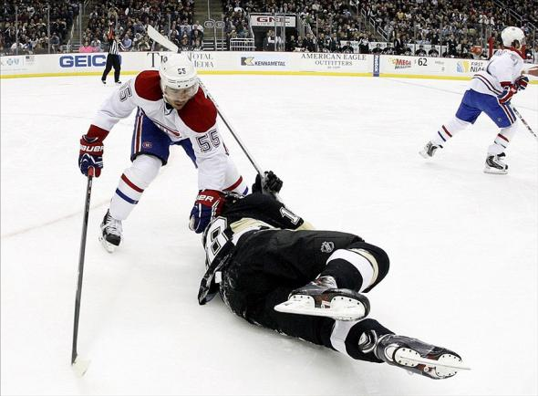 Jan 22, 2014; Pittsburgh, PA, USA; Montreal Canadiens defenseman Francis Bouillon (55) commits a holding penalty on Pittsburgh Penguins left wing James Neal (18) during the second period at the CONSOL Energy Center. The Penguins won 5-1. Mandatory Credit: Charles LeClaire-USA TODAY Sports