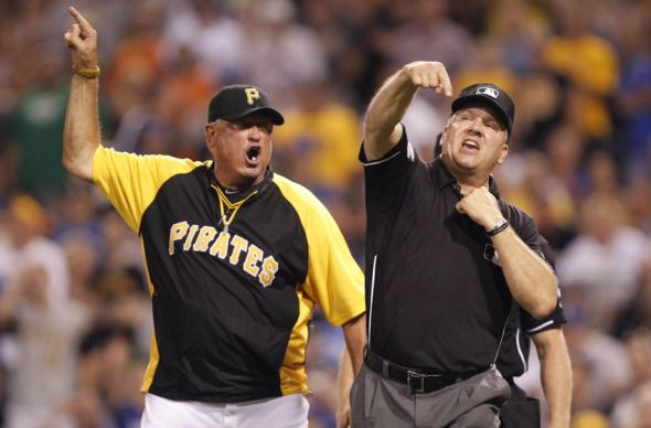 Jul 22, 2014; Pittsburgh, PA, USA; Pittsburgh Pirates manager Clint Hurdle (13) is ejected by third base umpire Jeff Nelson (45) against the Los Angeles Dodgers during the seventh inning at PNC Park. Mandatory Credit: Charles LeClaire-USA TODAY Sports