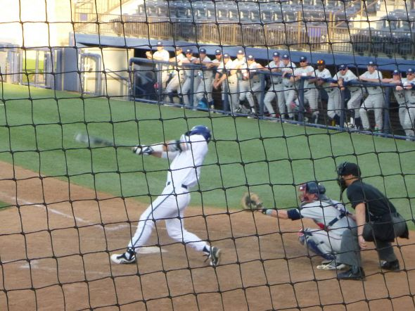 USD's Kyle Holder follows through with his home run swing in the bottom of the second inning.