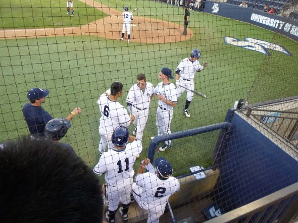 USD's Jessie Jenner (center) is greeted at the dugout by Connor Joe (#6) after a solo home run in the bottom of the third.