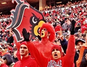 The Redbird cheering on Louisville football on a fold fall day!