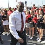 Sep 7, 2013; Louisville, KY, USA; Louisville Cardinals head coach Charlie Strong walks to the stadium during the Card March before the game against the Eastern Kentucky Colonels at Papa John