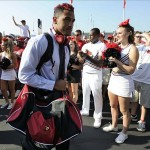 Sep 7, 2013; Louisville, KY, USA; Louisville Cardinals wide receiver Kai De La Cruz (12) walks to stadium during the Card March before the game against the Eastern Kentucky Colonels at Papa John