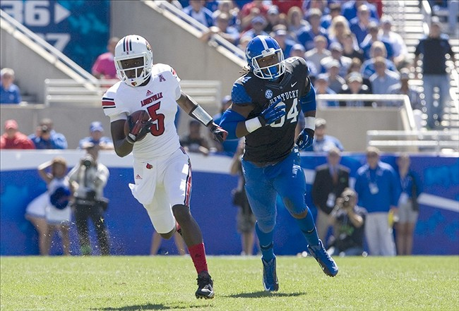 Sep 14, 2013; Lexington, KY, USA; Louisville Cardinals quarterback Teddy Bridgewater (5) runs the ball against Kentucky Wildcats defensive end Za