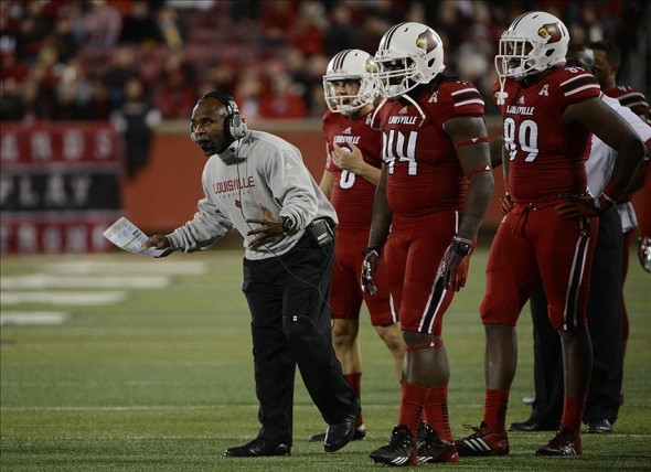 Nov 16, 2013; Louisville, KY, USA; Louisville Cardinals head coach Charlie Strong reacts during the second half of play against the Houston Cougars at Papa John