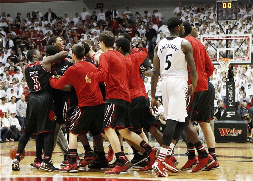 Feb 22, 2014; Cincinnati, OH, USA; Louisville Cardinals player celebrate at the end of the game against the Cincinnati Bearcats at FifthThird Arena. Louisville defeated Cincinnati 58-57. Mandatory Credit: Frank Victores-USA TODAY Sports