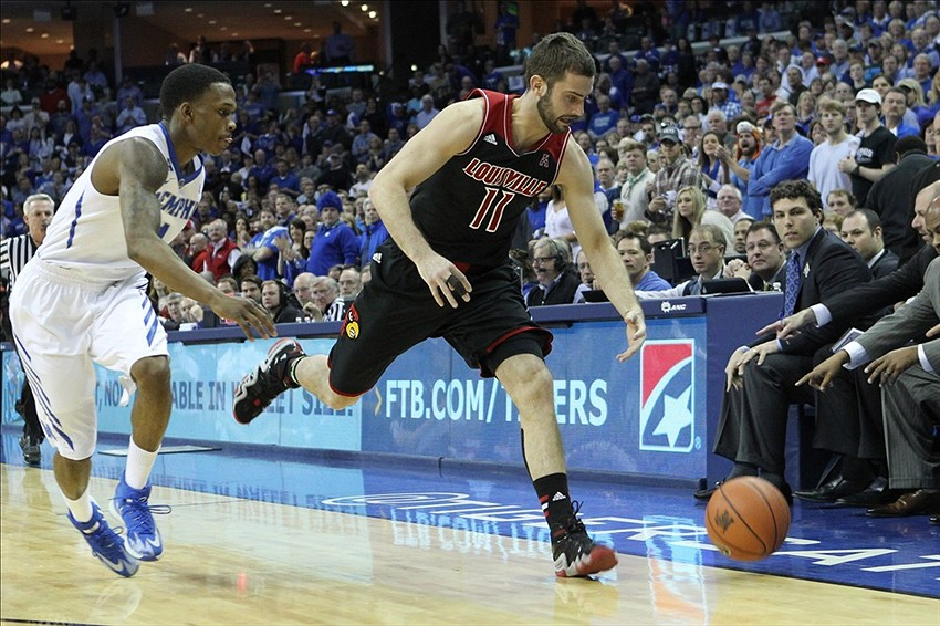 Mar 1, 2014; Memphis, TN, USA; Louisville Cardinals forward Luke Hancock (11) loses the ball out of bounds defended by Memphis Tigers guard Joe Jackson (1) during the first half at FedExForum. Mandatory Credit: Nelson Chenault-USA TODAY Sports
