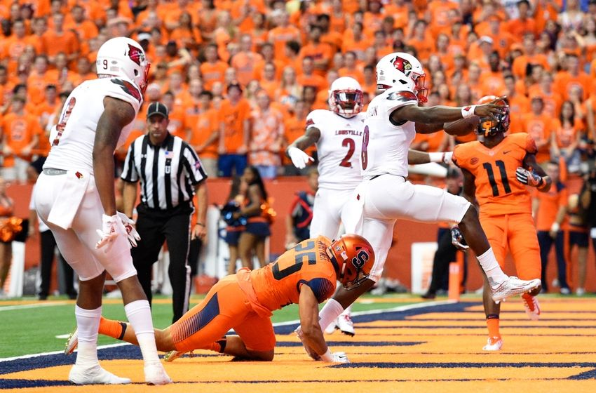 Sep 9, 2016; Syracuse, NY, USA; Louisville Cardinals quarterback Lamar Jackson (8) runs into the end zone for a touchdown against the Syracuse Orange during the first quarter at the Carrier Dome. Mandatory Credit: Rich Barnes-USA TODAY Sports