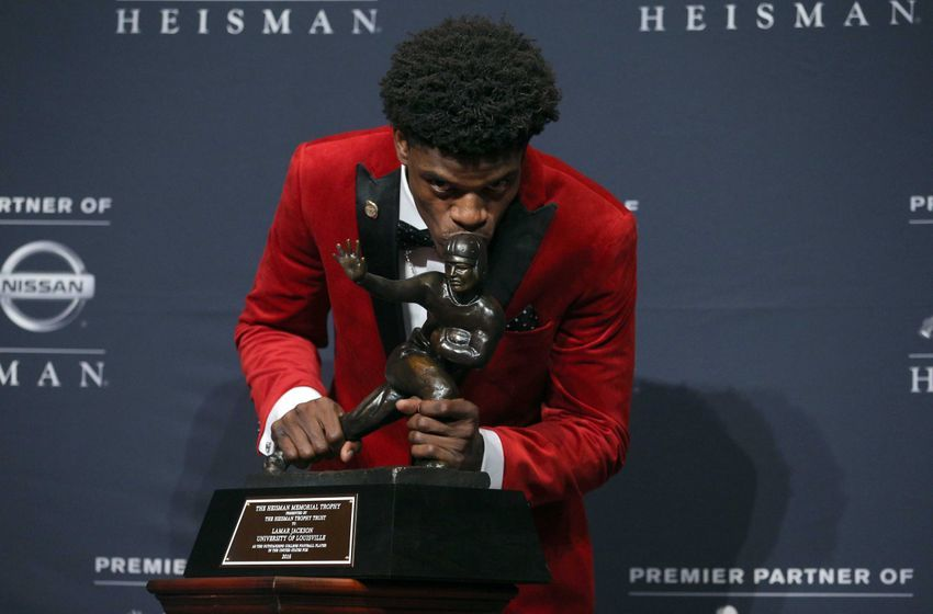 Dec 10, 2016; New York, NY, USA; Louisville quarterback Lamar Jackson poses with the trophy during a press conference at the New York Marriott Marquis after winning the 2016 Heisman Trophy award during a presentation at the Playstation Theater. Mandatory Credit: Brad Penner-USA TODAY Sports
