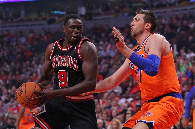 Oct 31, 2013; Chicago, IL, USA; Chicago Bulls small forward Luol Deng (9) drives against New York Knicks power forward Andrea Bargnani (77) during the first quarter at United Center. Mandatory Credit: Dennis Wierzbicki-USA TODAY Sports