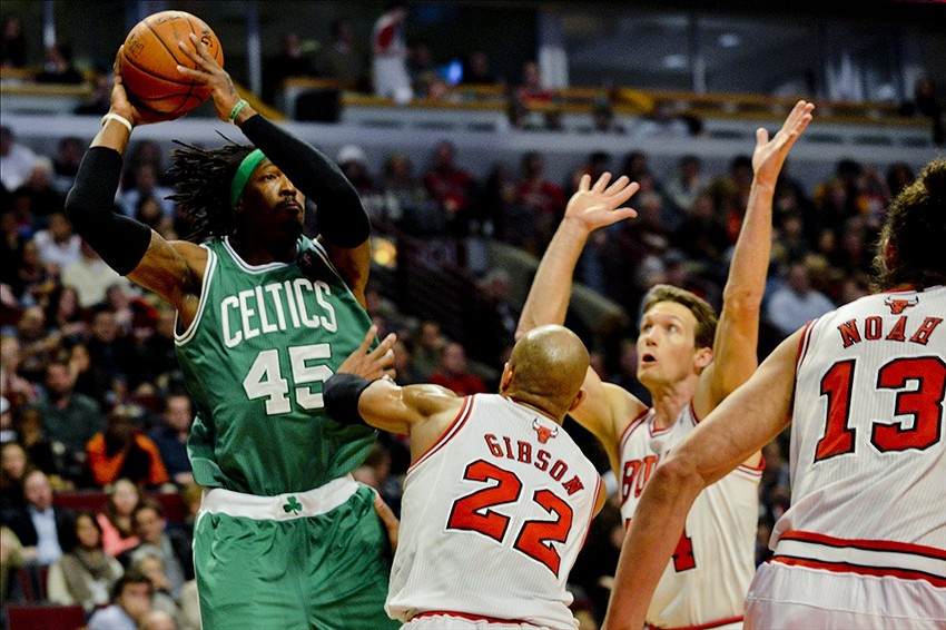 Jan 2, 2014; Chicago, IL, USA; Boston Celtics small forward Gerald Wallace (45) passes over Chicago Bulls power forward Taj Gibson (22), and Chicago Bulls small forward Mike Dunleavy (34) during the first half at the United Center. Mandatory Credit: Matt Marton-USA TODAY Sports