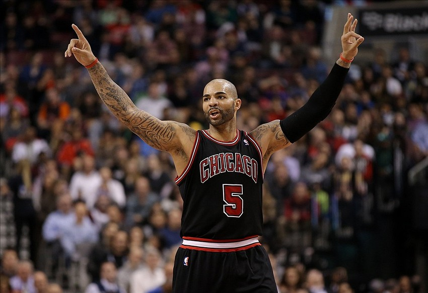 Feb 19, 2014; Toronto, Ontario, CAN; Chicago Bulls forward Carlos Boozer (5) celebrates a three-pointer by Kirk Hinrich (not pictured) against the Toronto Raptors at Air Canada Centre. Mandatory Credit: Tom Szczerbowski-USA TODAY Sports