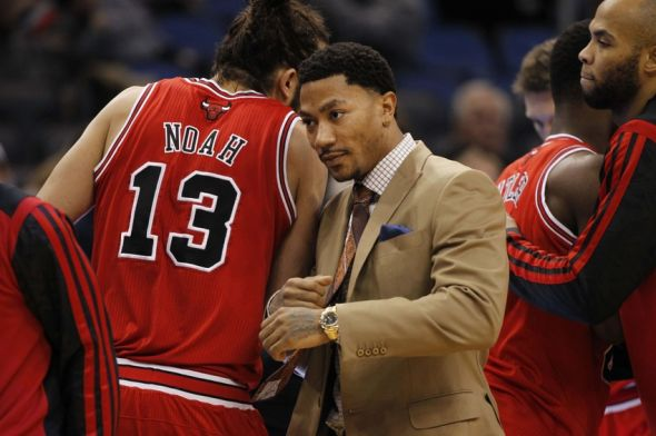 Jan 15, 2014; Orlando, FL, USA; Chicago Bulls point guard Derrick Rose (middle) and center Joakim Noah (13) before the game against the Orlando Magic at Amway Center. Mandatory Credit: Kim Klement-USA TODAY Sports