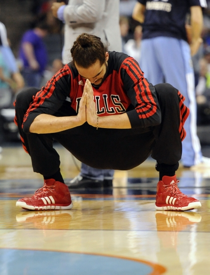 Apr 16, 2014; Charlotte, NC, USA; Chicago Bulls center Joakim Noah (13) warms up before the game against the Charlotte Bobcats at Time Warner Cable Arena. Mandatory Credit: Sam Sharpe-USA TODAY Sports