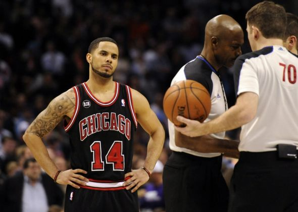 Apr 16, 2014; Charlotte, NC, USA; Chicago Bulls guard D.J. Augustin (14) looks on as the referees talk during the second half of the game against the Charlotte Bobcats at Time Warner Cable Arena. Bobcats win in overtime 91-86. Mandatory Credit: Sam Sharpe-USA TODAY Sports