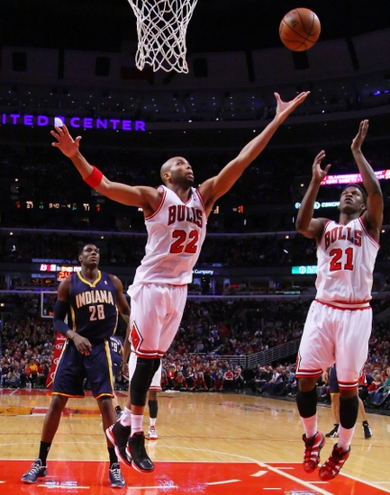 Mar 23, 2013; Chicago, IL, USA; Chicago Bulls power forward Taj Gibson (22) and small forward Jimmy Butler (21) battle for a rebound during the second half against the Indiana Pacers at the United Center. Chicago won 87-84. Mandatory Credit: Dennis Wierzbicki-USA TODAY Sports