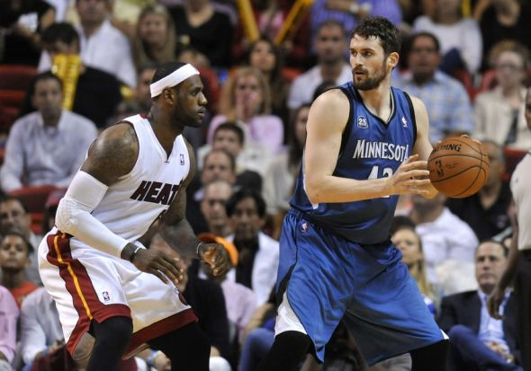 Apr 4, 2014; Miami, FL, USA; Minnesota Timberwolves forward Kevin Love (42) is pressured by Miami Heat forward LeBron James (6) during the second half at American Airlines Arena. The Minnesota Timberwolves won in 2 overtimes 122-121. Mandatory Credit: Steve Mitchell-USA TODAY Sports