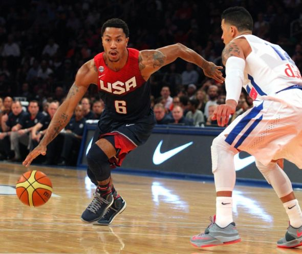 Aug 22, 2014; New York, NY, USA; United States guard Derrick Rose (6) controls the ball in front of Puerto Rico guard David Huertas (12) during the second quarter of a game at Madison Square Garden. Mandatory Credit: Brad Penner-USA TODAY Sports