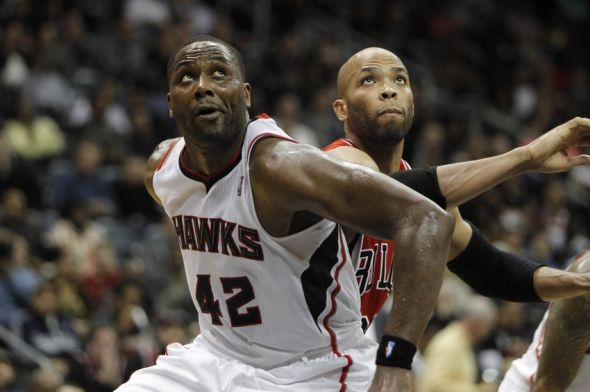 Feb 25, 2014; Atlanta, GA, USA; Atlanta Hawks power forward Elton Brand (42) and Chicago Bulls power forward Taj Gibson (22) fight for a rebound in the second quarter at Philips Arena. Mandatory Credit: Brett Davis-USA TODAY Sports