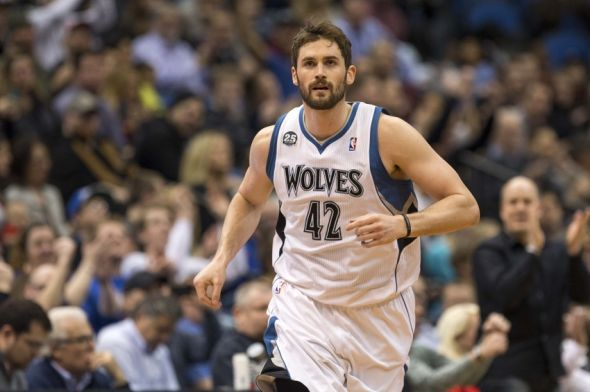 Mar 28, 2014; Minneapolis, MN, USA; Minnesota Timberwolves forward Kevin Love (42) runs on the court in the first half against the Los Angeles Lakers at Target Center. Mandatory Credit: Jesse Johnson-USA TODAY Sports